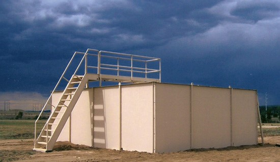 Modular MOBILE Shoothouse set up on level ground at a military tactical training facility.