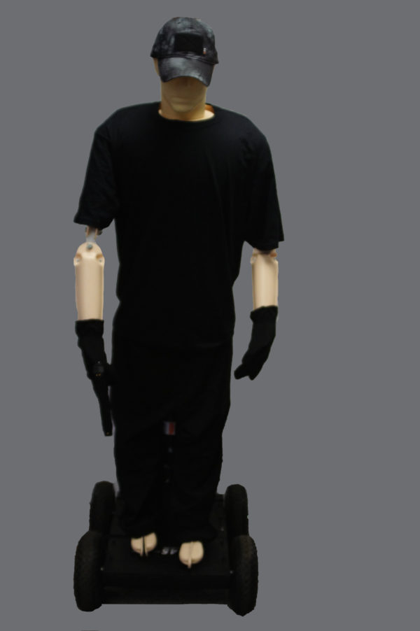 """Dressed in black, Manikin Mike is mounted on M-145 """"Renegade"""" Robotic Moving Target System."""